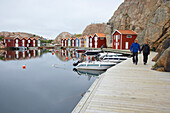 Boats and boat houses in the port of Smoegen, Sotenas Peninsula, Province of Bohuslaen, West coast, Sweden, Europe
