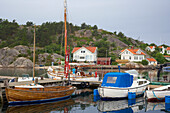 Boats and boat houses in the port of Havestensund, Province of Bohuslaen, West coast, Sweden, Europe