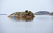 Rocky island with hut at Edsvik near Grebbestad, Province of Bohuslaen, West coast, Sweden, Europe