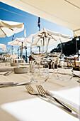 Close up of glasses on a table, restaurant, Portofino, province of Genua, Italian Riviera, Liguria, Italy