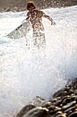 Surfer in spray, Jakarta, Java, Indonesia