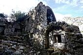 Woman visiting ancient ruins beside long-distance footpath Lycian Way, Antalya, Turkey