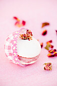 Macaron with candied rose blossoms