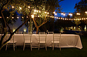 Set table in the evening light, Masseria, Alchimia, Apulia, Italy