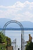 Garden gate, view to Starnberger See, Upper Bavaria, Bavaria, Germany