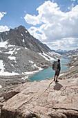 Hiker enjoys the views above the Darwin Lakes California Bishop, California, USA