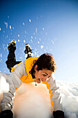 A Latina woman on a snow slide in the mountains, North Cascades National Park, Washington, USA
