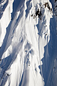 A male extreme skier skis a big mountain first descent in Haines, Alaska Haines, Alaska, USA