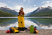 Portrait of young female kayaker having fun in front of a beautiful lake deep in Glacier National Park Glacier National Park, Montana, USA
