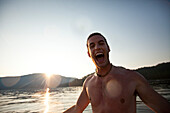 Young adult enjoys being out on the lake in Idaho Sandpoint, Idaho, USA