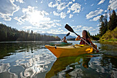 Young adult couple kayak on a beautiful summer day in Idaho Sandpoint, Idaho, USA