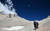 Guided mountaineering team making a carry up to High Camp on Aconcagua, Andes Mountains, Argentina, Mendoza, Andes Mountains, Argentina