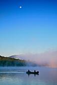 Canoeing in morning fog on Lake Eaton, Adirondack Park, USA, Long Lake village, NY, USA