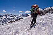 A man ski mountaineering through penitentes on Volcan San Jose in the Andes mountains of Chile, Chile
