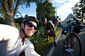 Three cyclists smile for a portrait during a bike ride in Monmouth, Maine Monmouth, Maine, United States of America