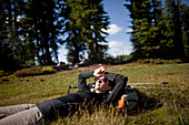 A young woman rests after hiking to Jefferson Park in the North Oregon Cascades in September, 2010 Oregon, USA