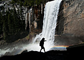 A man hikes along the Mist Trail to Vernal Fall in Yosemite National Park, California Yosemite, California, USA