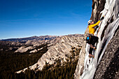 An ice climber climbs Yellow Brick Road (WI3+) on Drug Dome in Tuolumne Meadows located inside Yosemite National Park, California., Yosemite National Park, California, United States of America