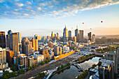 Hot air balloons aloft over Melbourne city at dawn, Victoria, Australia., Melbourne, Victoria, Australia