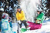 A playful group of snowboarders enjoy an unbridled moment of fun in the snow., Vail, Colorado, USA
