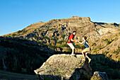 A couple enjoys the beauty of a Summer hiking adventure., South Lake Tahoe, CA, California, USA