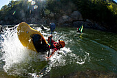Overhead view of two kayakers doing tricks on a river in flat water., Fayetteville, WV, USA