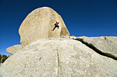 Male lead climbing on a boulder, Bishop, California, United States