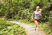 Runner on boardwalk in forest Trinidad, California, United States