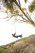 A woman on a rope swing in California, San Pedro, California, United States