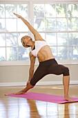 A woman doing yoga in a studio Long Beach, California, United States