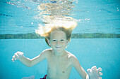 A young boy swims in a pool, San Clemente, California, United States
