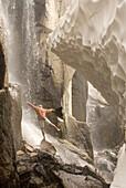 Hiker under waterfall Bridgeport, California, United States