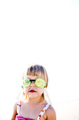 Little girl in bathing suits and goggles, Carlsbad, California, United States
