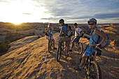 group taking a break while mountain biking in Moab, Utah, Moab, Utah, United States