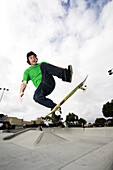 A skateboarder does a trick in mid air Carlsbad, California, United States