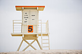 A beach lifeguard stand on an overcast morning in Huntington Beach, California Huntington Beach, California, United States