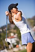 A woman swings a golf club Hollywood, California, United States