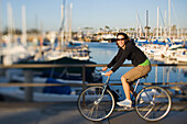 A woman riding a bike on a sunny spring afternoon in Long Beach, California Long Beach, California, United States