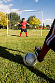 A boy stands ready to block the shot in a soccer game, Fort Collins, Colorado Fort Collins, Colorado, USA