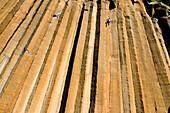 A mid adult man rock climbing at Trout Creek, Oregon Madras, Oregon, USA