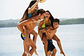 South American couples playing at beach, Morrocoy, Venezuela