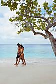 South American couple walking on beach, Morrocoy, Venezuela