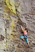 Asian woman rock climbing, Vantage, WA