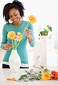 African woman arranging flowers, Jersey City, NJ