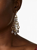 African woman wearing glamorous earrings, New York, NY