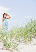 Hispanic girl viewing scenery at beach, Rockaway Beach, NY