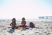 Young mixed race girls playing at beach, Venice Beach, CA