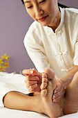 Asian female doctor performing Acupuncture treatment, Gaithersburg, MD