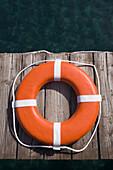Round life preserver on wooden dock, Lake Tahoe, CA