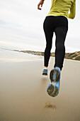 Hispanic woman running on beach, Newport Beach, CA